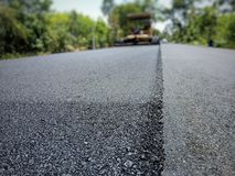 Road construction. Asphalt road construction in Thailand, blurred images stock image