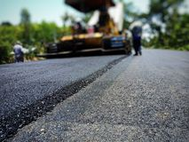 Road construction. Asphalt road construction in Thailand, blurred images royalty free stock photo