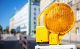Road Construction Concept. Orange Warning Light. Blur City Background, Space Royalty Free Stock Images