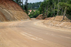 Road construction,Dirt road,New road surface. Stock Image