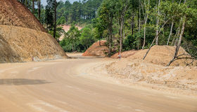 Road construction,Dirt road,New road surface. Royalty Free Stock Photography