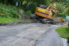 Road construction excavator. Road construction tractor excavator shovel grader Stock Photos
