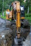 Road construction excavator. Road construction tractor excavator shovel grader Royalty Free Stock Photo