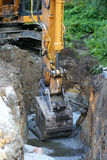 Road construction excavator Stock Images