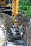 Road construction excavator. Road construction tractor excavator shovel grader Stock Images