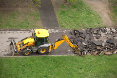 Road construction machine breaks up old asphalt road Royalty Free Stock Images