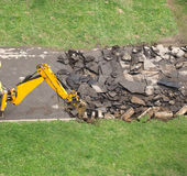 Road construction machine breaks up old asphalt road Stock Photography
