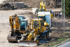 Road construction machineries on local industrial park. Miercurea Ciuc, Romania- 06 April 2019: Road construction machineries on local industrial park royalty free stock photography
