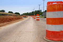 Road Construction Pylon. A row of traffic cones indicate road construction Royalty Free Stock Photo