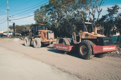 Road construction with Road Roller Machine and Wheel Loader on sunset in Coral Springs, FL stock photos