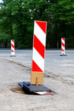 Road construction sign. S placed on the reparing road royalty free stock photo