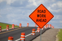 Road Construction Sign. Road construction zone with orange warning sign Royalty Free Stock Photo