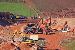 Road construction site. Diggers on a road construction site Stock Image