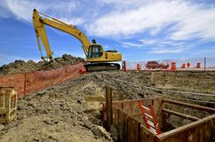 Road construction site with excavating machine Stock Photography
