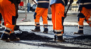 Road construction, teamwork Stock Images