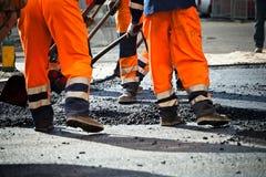 Road construction, teamwork Royalty Free Stock Image
