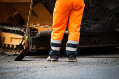 Road construction worker and shovel Royalty Free Stock Images