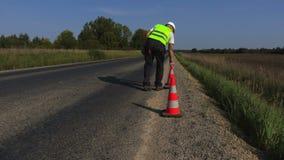 Road construction worker talk on walkie-talkie stock video