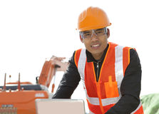 Road construction worker using laptop Stock Photo