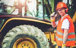 Road Construction Worker. Road Work Job. Caucasian Highway Worker in His 30s Wearing Hard Hat and Safety Glasses. Road Construction Royalty Free Stock Image