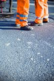 Road construction and workers Royalty Free Stock Photo