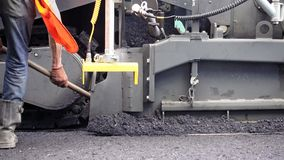 Road construction. Workers applying new asphalt. Stock Images