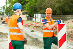 Road construction workers Royalty Free Stock Image
