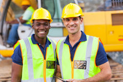 Road construction workers. Two cheerful male road construction workers on construction site Royalty Free Stock Images