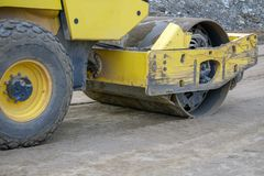 Road construction works with roller compactor machine and asphalt finisher stock photos