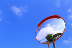 Road convex mirror. Against the sky Stock Images