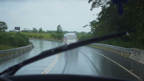 The road cornering during heavy tropical rain stock video