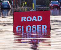A Road Cosed sign at a flooded road Royalty Free Stock Photography