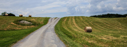 Road in the country and hay. Road in the country with hay on the side Royalty Free Stock Photo