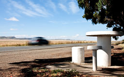 Road in the country side with picnic site. And blurred car Stock Image