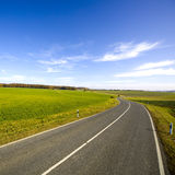 Road in countryside Stock Images