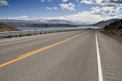 Road through a countryside mountain range snow. Photo transport road through a countryside mountain range snow Royalty Free Stock Photo