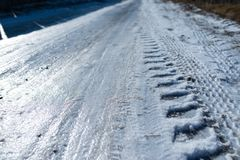 Road covered with ice, car tracks royalty free stock photos