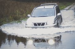 Car driving through water Stock Image