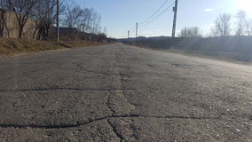 Road with cracks Royalty Free Stock Image