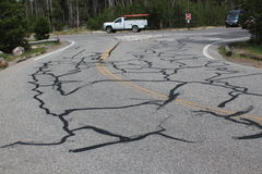 Road cracks repaired by tarmac Royalty Free Stock Photo