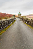 Road on the Craig Goch reservoir and dam Stock Photos
