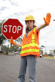Road Crew Stop Sign. A female construction worker stopping traffic Stock Images