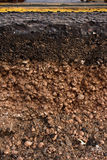 Road cross section showing soil underneath. Cut away cross section of a street with exposed soil underneath while maintenance work for utilities company is in Stock Image