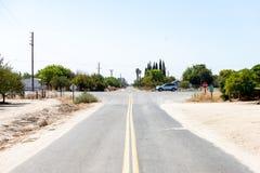 Road crossing in almond farmland. Near San Francisco in California stock photos