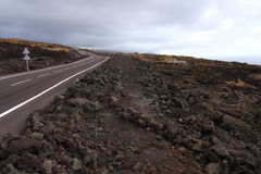 Road crossing a lava flow Royalty Free Stock Images
