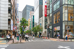 Road crossing with people and traffic in Ginza suburb, Tokyo. Tokyo, Japan - August 30, 2016: Road crossing with people and traffic in Ginza suburb, Tokyo Stock Photo