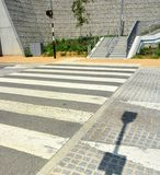 A raised Zebra Crossing point. Traffic calming measure. A road crossing point where cobblestones are set at an angle to a raised zebra crossing acting as an royalty free stock images
