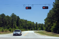 Road crossing and red lights Royalty Free Stock Images