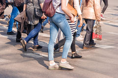 Road crossing with women, pedestrian feet Stock Images