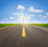 Road and crucifix Royalty Free Stock Images